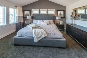 Modern comfortable, nicely decorated and elegant luxury master bedroom. Interior design.